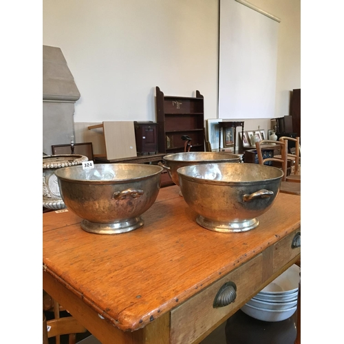 324 - Three silver plated serving bowls. AHC....