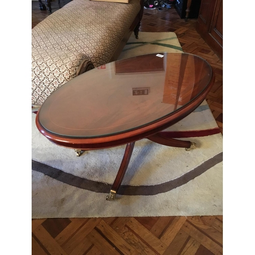 340 - Oval mahogany inlaid coffee table with glass protector....