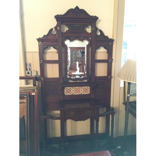 387 - Carved Victorian mahogany mirrored backed and tiled hallstand....