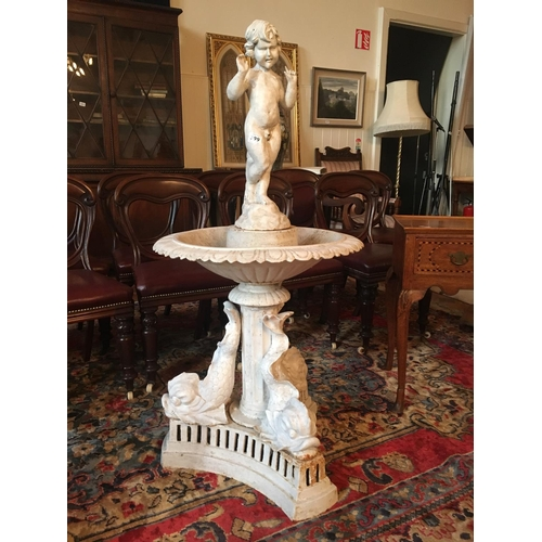 399 - Victorian cast iron fountain with cherub decoration terminating on carp fish supports....