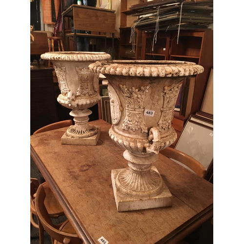 483 - Pair of cast metal classical shape garden urns....