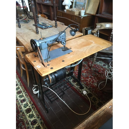 47 - Singer table base electric sewing machine....