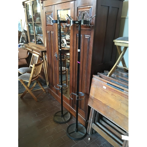 58 - Three metal coat stands....