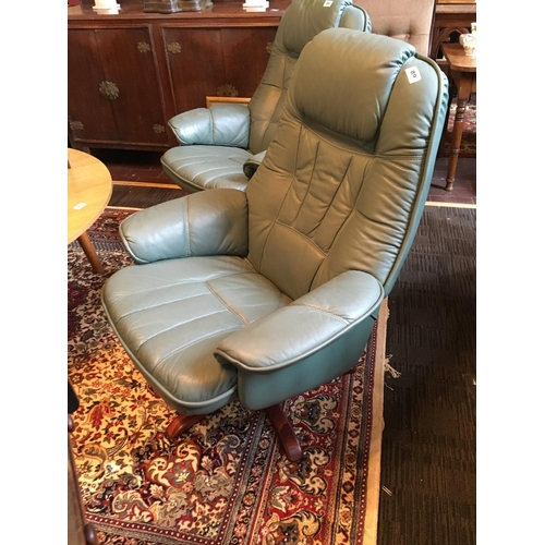 89 - Swivel Leather armchair....