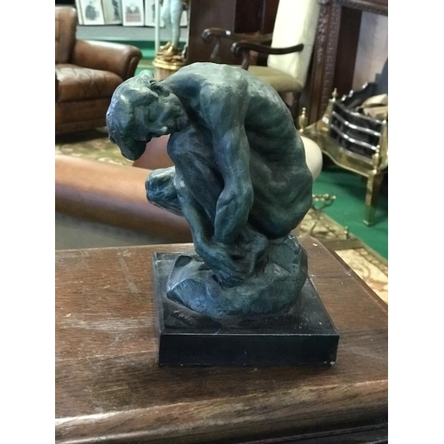 42 - Bronze study of a crouching man on a marble base 5'' W x 7'' D x 8''...