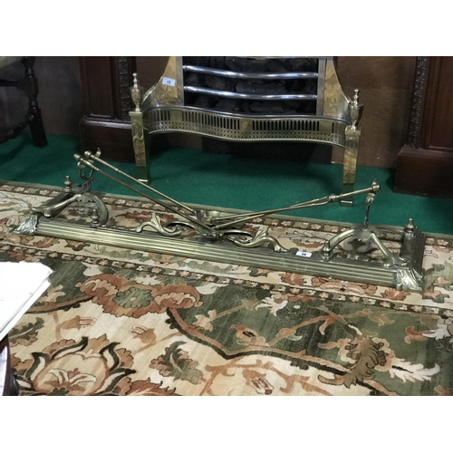 16 - 19th Century brass fender complete with 3 irons 54'' W x 14'' D...