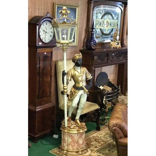 5 - Ex Cafe en Seine Fine pair of Blackmoors gilded and painted with marbelised bases 83'' H...