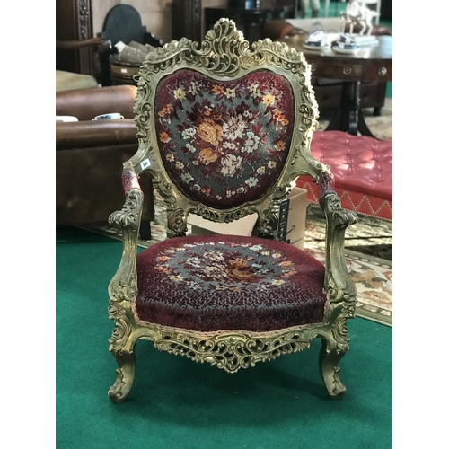 6 - Ex Odessa Club Iconic carved wood and gilt armchair with tapestry upholstery 29''W...