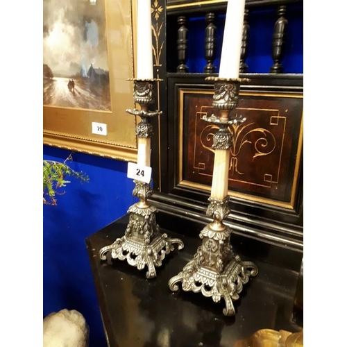 24 - Pair of decorative metal and marble candlesticks. (30 cm )....