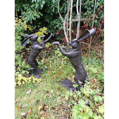 16 - Pair of bronze models of boxing hares. { 89cmm H }....