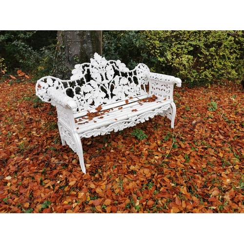 18 - Cast iron arched back garden seat oak leaf design with the arms terminating with a dog's head.  { 14...