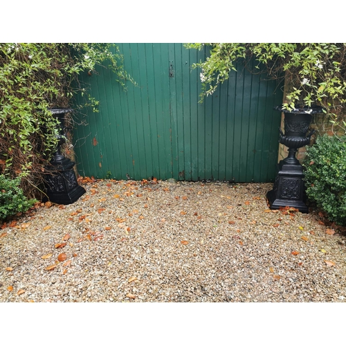 2 - Pair of decorative cast iron garden urns. { 104cm H X 48cm W }....