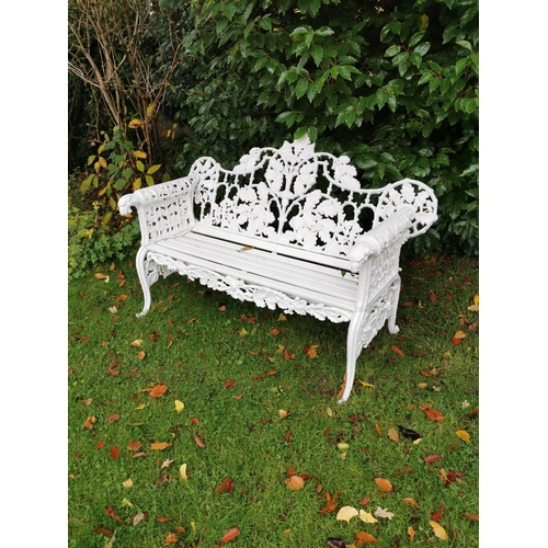 27 - Cast iron arched back garden seat oak leaf design with the arms terminating with a dog's head.  { 14...