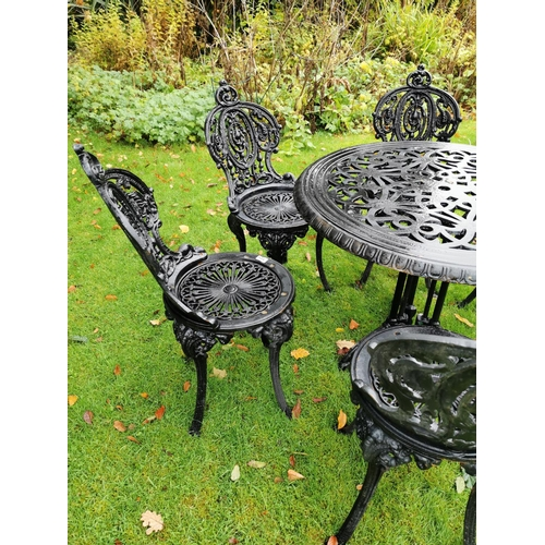 28 - Set of six cast iron garden chairs and matching table. { 88cm Dia. }....
