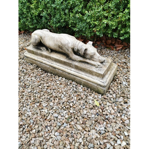 3 - Pair stone seated grey hounds on square plinth.  { 31cm H X 73cm W X 22cm D }....