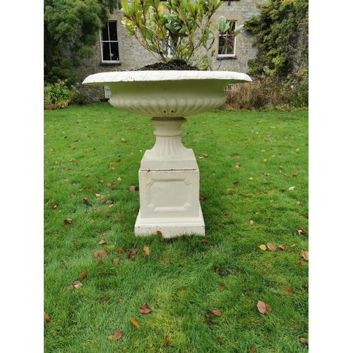 32 - Cast iron urn centre piece on matching plinth .  { 90cm H X 84cm W }....