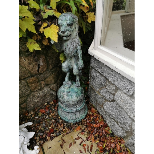 36A - Bronze sculpture of mythical Lion standing on ball. { 125cm H }....