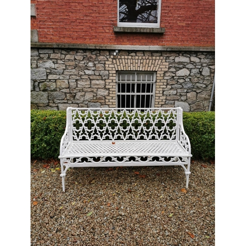 4 - Decorative cast iron garden seat in the Gothic style. { 84cm H X 135cm W X 51cm D }....