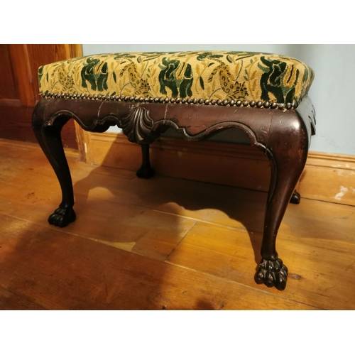 53 - 19th C. Irish mahogany upholstered foot stool on claw feet {38 cm H x 52 cm W x 54 cm D}....
