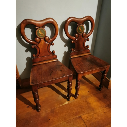 54 - Pair of William IV mahogany hall chairs with central hand painted plaques depicting an owl {93cm H x...