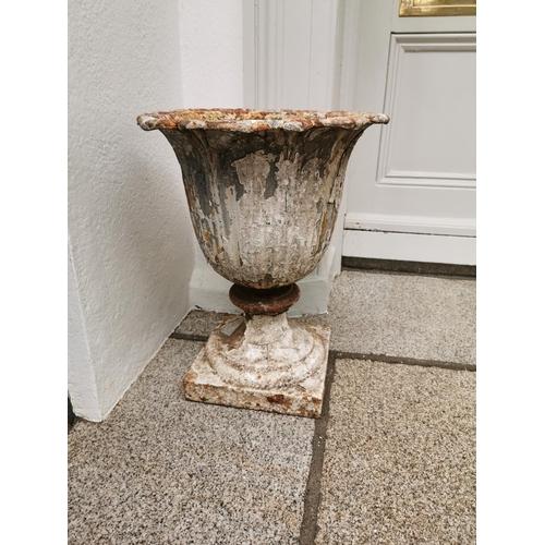 7 - Good quality pair of 19th. C. cast iron garden urns.  { 55cm H X 44cm W }....