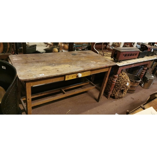 10 - 19th. C. pine kitchen table with double stretchers. (136 cm L x 65 cm W x 76 cm H)....