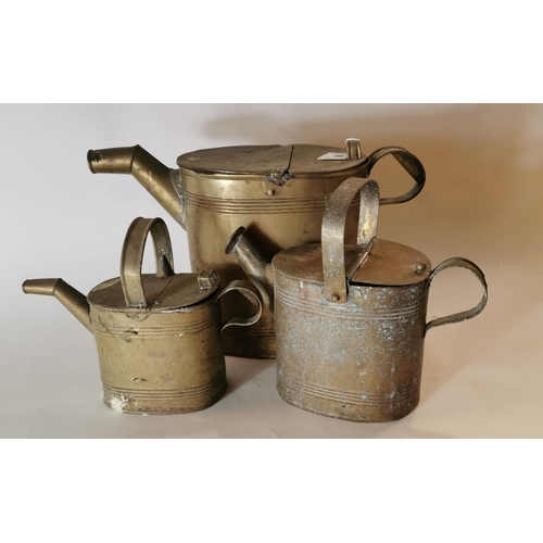 19 - Three 19th. C. graduated brass watering cans....