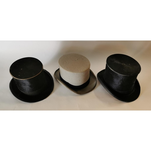 21 - Two 19th. C. top hats and a later hat....