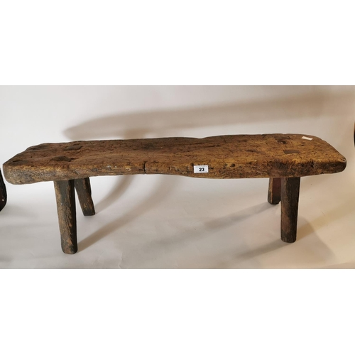 23 - 19th. C. pine bench on four tapered legs. (114 cm L x 34 cm H)....