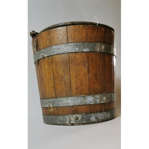 32 - 19th. C. oak bucket with metal straps. (32 cm H )...