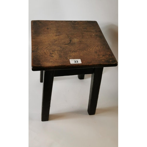 33 - 19th. C. elm and oak stool with four legs. (35 cm H)...