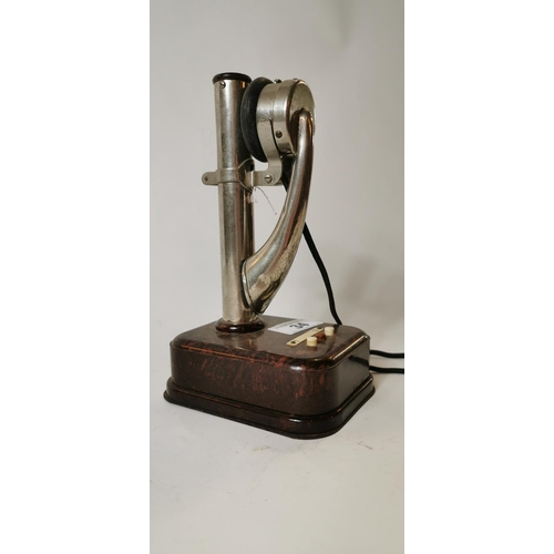 34 - Rare 20th C. chrome and Bakelite telephone {25 cm H}...