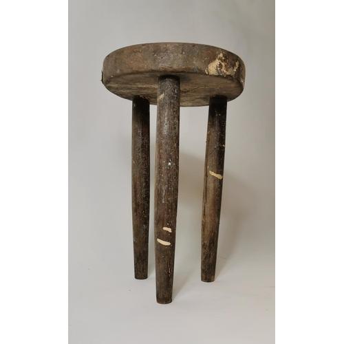 40 - Late 19th. C. pine three legged milking stool. (37 cm H)....