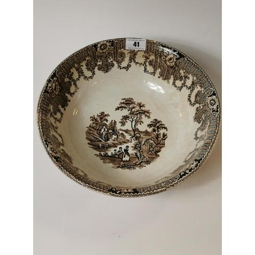 41 - 19th. C. brown  transfer ware potato bowl with rural scenes. (37 cm W)....
