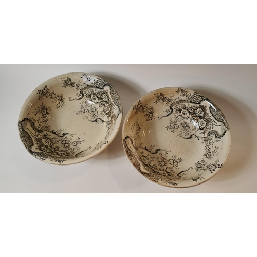 42 - Two 19th. C. transfer basins brown and white with floral decoration....