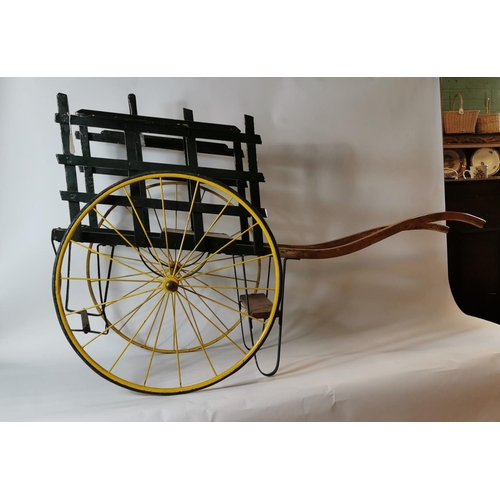 56 - 19th. C. painted pine child's cart with metal wheels....