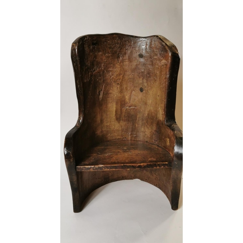 59 - 19th. C. child's pine dugout chair....