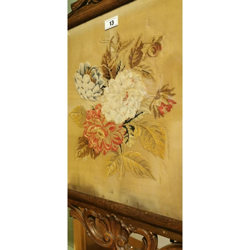 13 - 19th. C. rosewood fire screen with inset tapestry panel raised on bobbin supports on two out swept l...