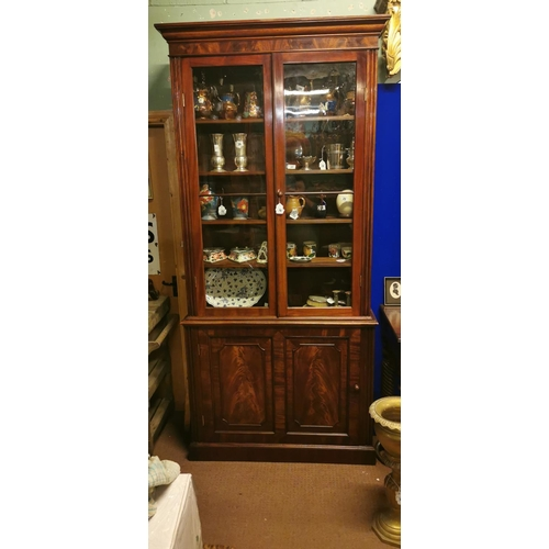16 - 19th. C. mahogany bookcase the two glazed doors above a single panelled door. {  250cm H  X  116cm W...