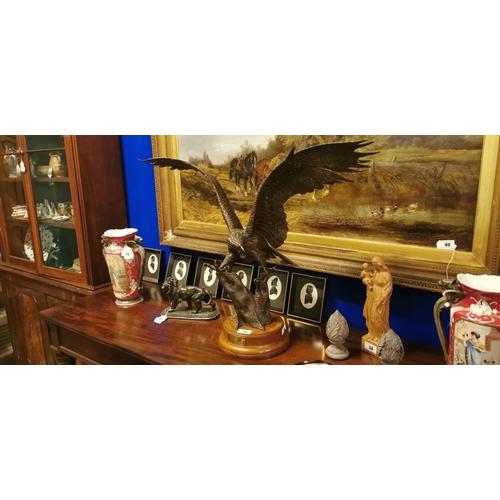 36 - Bronze sculpture of Eagle on circular base....