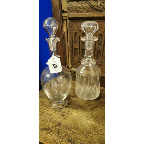 45 - Two 19th. C. cut glass decanters....