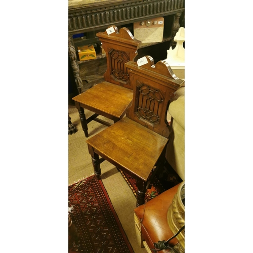 58 - Pair of 19th. C.  oak hall chairs....
