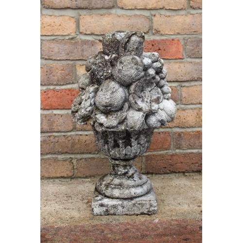 109 - Stone finial depicting a bowl of fruit {50 cm H x 26 cm Dia}....