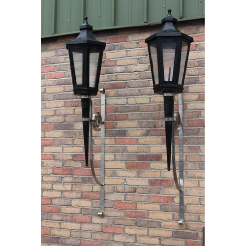 111 - Pair of stylish wall lights with chrome brackets {190 cm H x 40 cm Dia}....