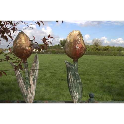 12 - Pair of decorative garden ornaments in the form of resin tulips in pots {200 cm H x 40 cm Dia.}....