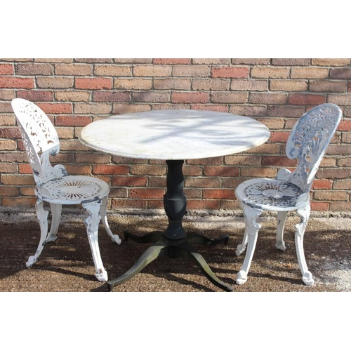 157 - Cast iron garden table with marble top and two aluminium garden chairs {Table 75 cm H x 90 cm Dia. C...