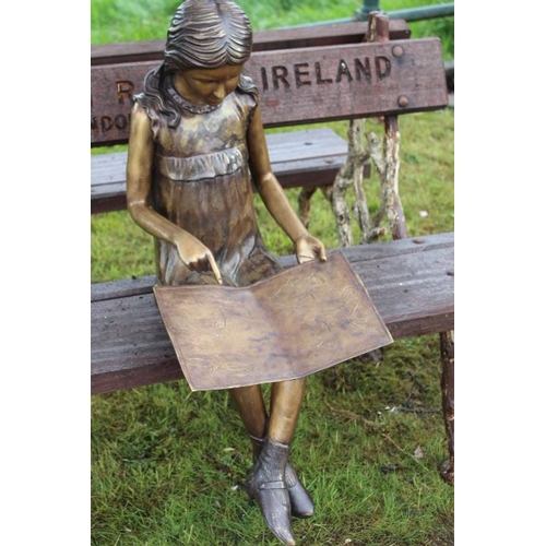 171 - Bronze figurine of a seated girl reading a book {70 cm H x 37 cm W x 70 cm D}....