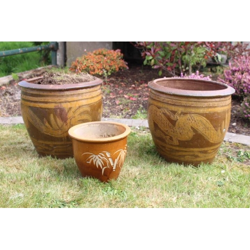 22 - Two matching terracotta pots {40 cm H x 40 cm Dia. Each} and another {20 cm H x 26 cm Dia.}....