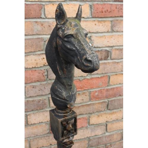 233 - Cast iron horses head tieing post {150 cm H x 34 cm W x 27 cm D}....