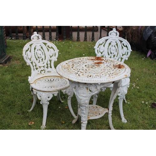 286 - Three piece decorative cast iron garden set - cast iron table {64 cm H x 57 cm Dia.} and two matchin...